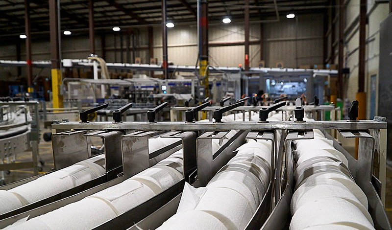 Detail image of bath tissue rolls being manufactured in facility